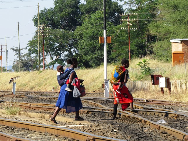 Women crossing railway tracks, Victoria Falls, Zimbabwe, May 2016