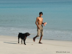 A boy and a dog, Andaman Islands, India 2010
