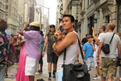 A yorkie and her person, NYC Pride March, 30 June 2013.