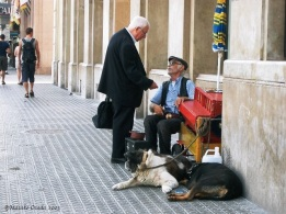 An old street performer and his accomplices, Barcelona, Spain