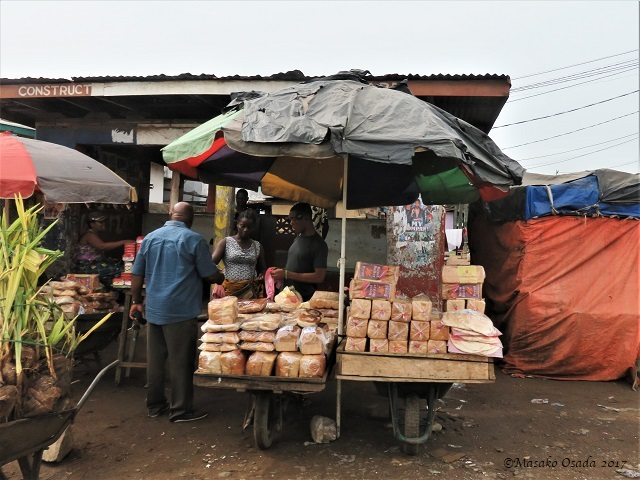 Bread seller, on the way to Katata, Liberia, April 2017