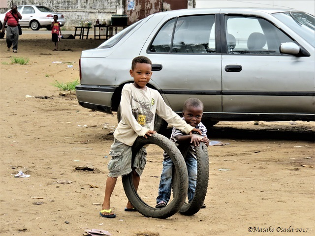 Boys playing with tyres, Monrovia, Liberia, April 2017