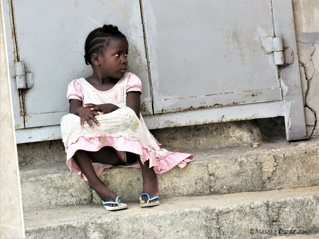 Girl sitting on the steps, Monrovia, Liberia, April 2017