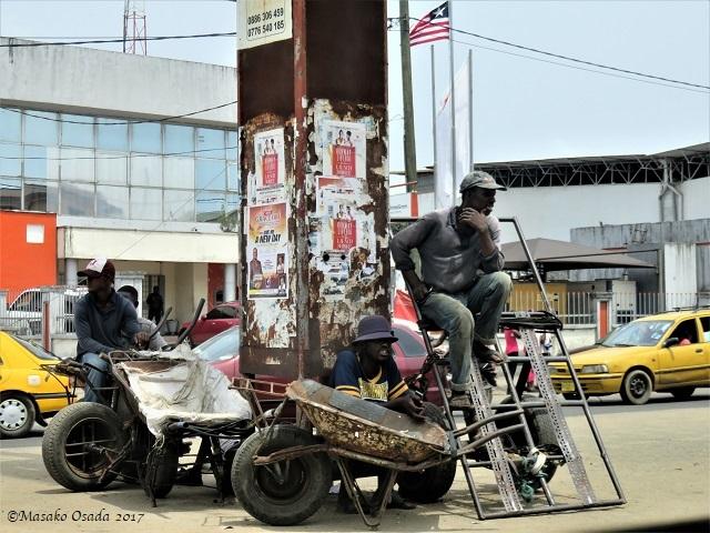 Three men on the street, Monrovia, Liberia, April 2017