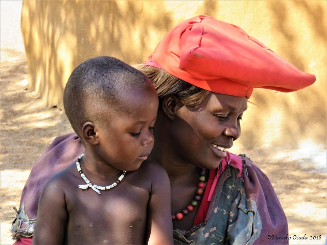 Herero lady with her son, Onjowewe Village, Namibia, May 2018