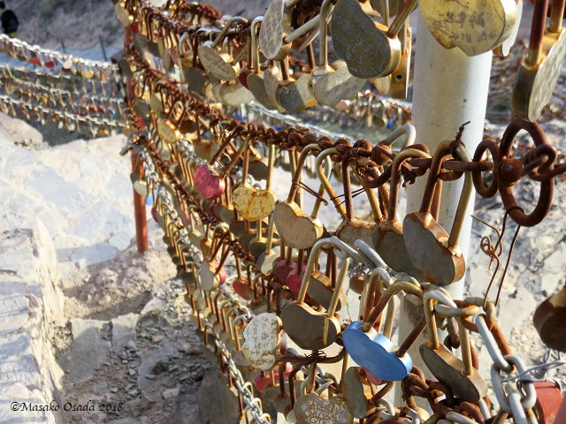 Love locks. Overhanging Great Wall, Jiayuguan, Gansu, September 2018