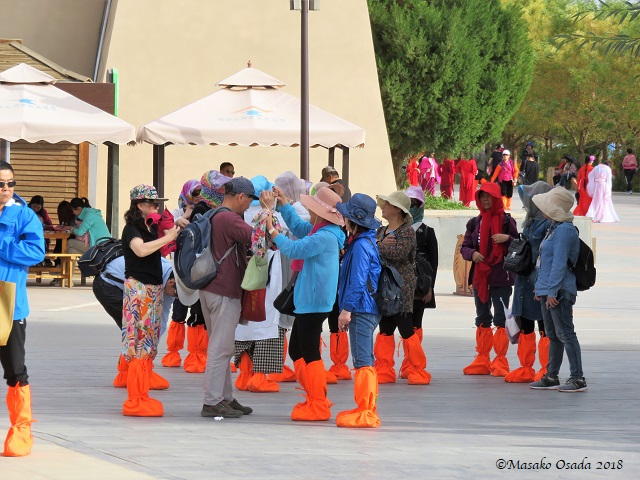 Red Boots Brigade. Mingsha Mountain Crescent Spring Resort, Dunhuang, Gansu, September 2018