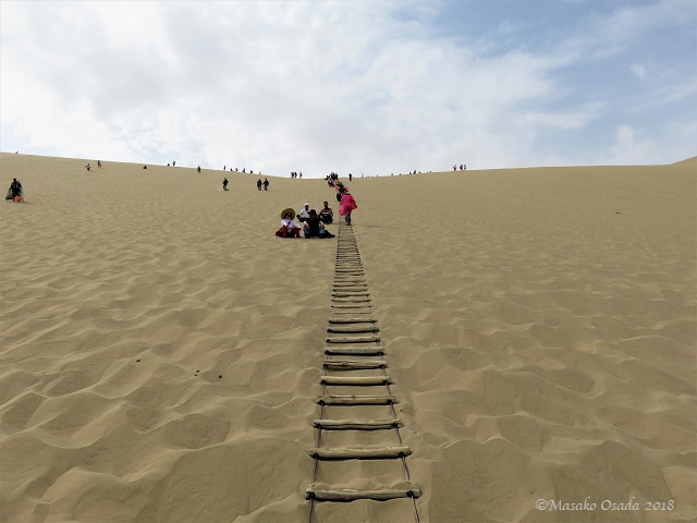 Dune climbing. Mingsha Mountain Crescent Spring Resort, Dunhuang, Gansu, September 2018