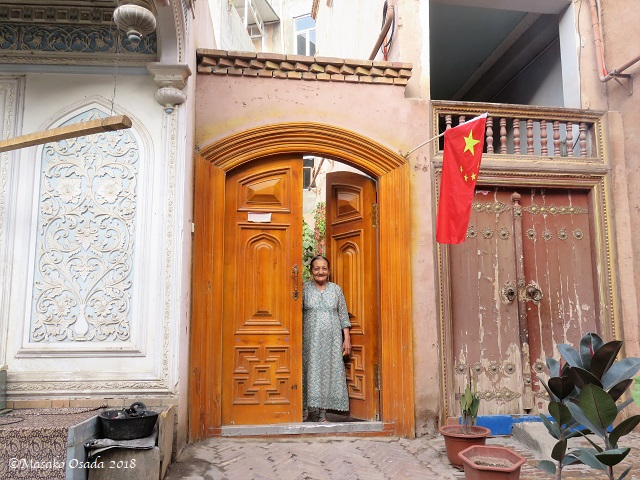 Lady of the house. Old City, Kashgar, Xinjiang, September 2018