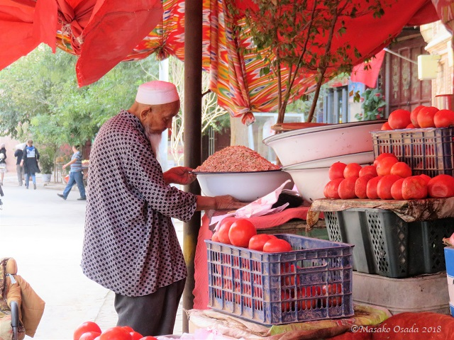 Fruit seller. Old City, Kashgar, Xinjiang, September 2018