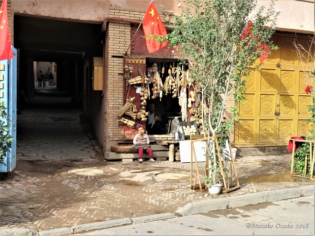Toy maker's granddaughter, Old City, Kashgar, September 2018