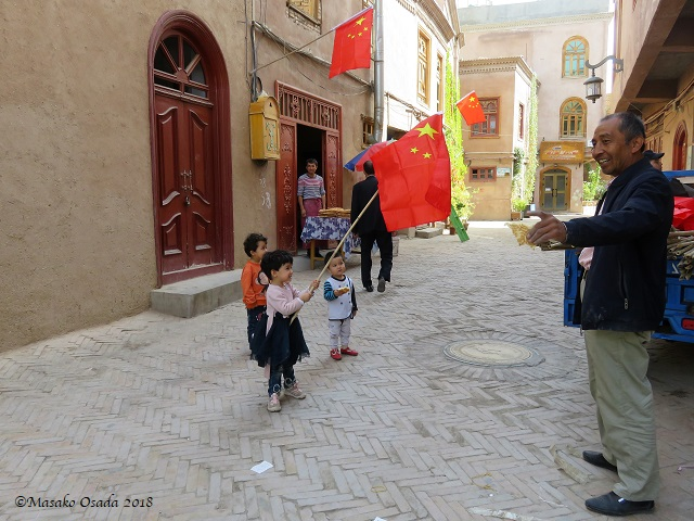 Young patriot? Old City, Kashgar, Xinjiang, September 2018