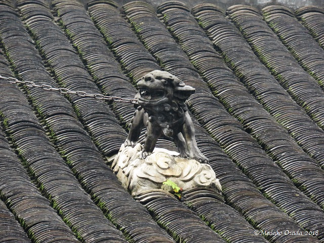 Lion on roof. Wenshu Monastery, Chengdu, Sichuan, September 2018